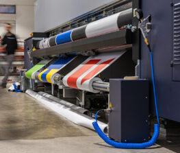 Very big printer during color sample phase, massive vinyl rolls,